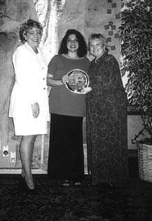 Frances Scarantino, an honoree of the Eckerd Salute to Woman Program, (c.) holds award with Eckerd representatives, Mona Furlott (l.) and Mary Beth Fox (r.).